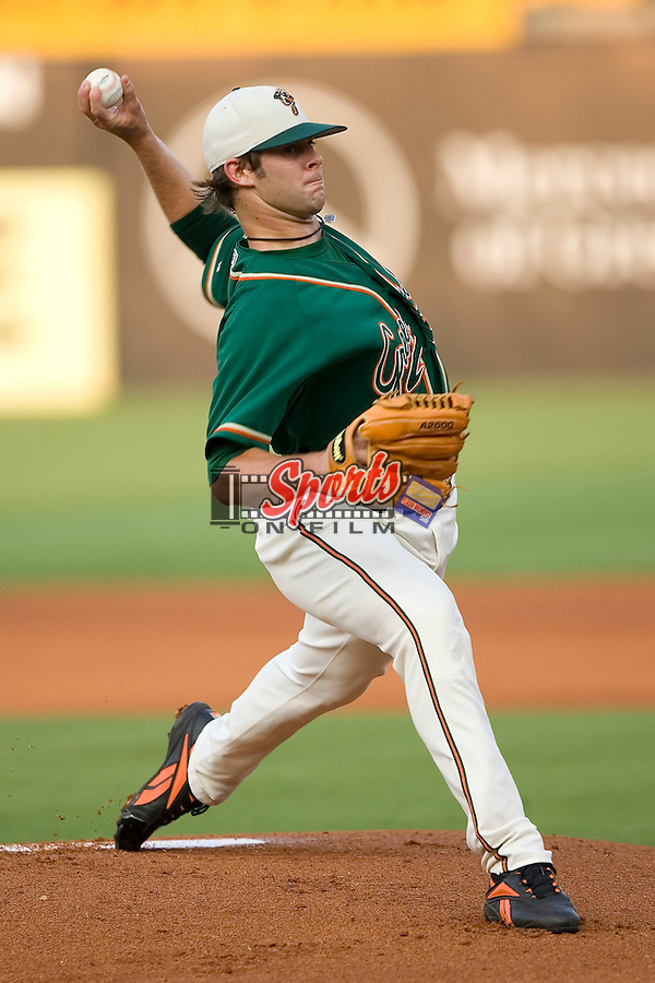 Greensboro Grasshoppers starting pitcher Aaron Thompson delivers the ball to the plate versus the West Virginia Power at First Horizon Park in Greensboro, NC, Wednesday, August 23, 2006.