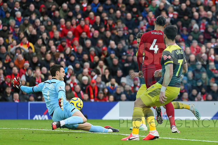 Virgil Van Dijk of Liverpool forces a save from Alex McCarthy of Southampton during the Premier League match at Anfield, Liverpool. Picture date: 1st February 2020. Picture credit should read: James Wilson/Sportimage