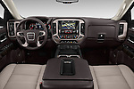 Stock photo of straight dashboard view of 2016 GMC Sierra 1500 Denali 4WD Crew Cab Short Box Denali 4 Door Pick-up Dashboard