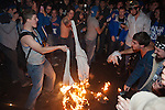 Kentucky fans burn shirts after UConn defeated UK 54-60 in Lexington, Ky., on Monday, April 7, 2014. Photo by Adam Pennavaria | Staff