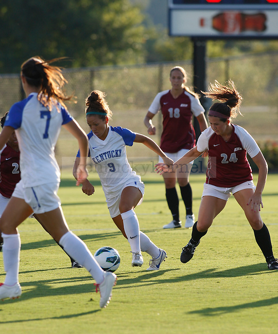 The UK Women's Soccer junior Caitlin Landis (9) handles the ball against Eastern Kentucky Colonels at UK Soccer Complex on Friday, Aug. 24, 2012. Photo by Scott Hannigan | Staff
