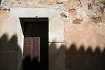 Roof shadow on an old facade, Caceres, Spain
