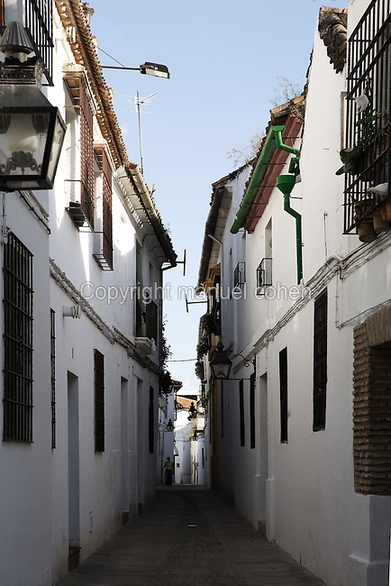 Narrow street of the Jewish Quarter, Cordoba, Andalusia, Spain; close as it was to the wall surrounding the royal apartments and to the centre of administrative power, the Jewish Quarter must have been quite extensive and important in the city from the X century. Picture by Manuel Cohen