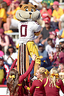 College Park, MD - OCT 15, 2016: the cheerleaders hold up Minnesota Golden Gophers mascot during game between Maryland and Minnesota at Capital One Field at Maryland Stadium in College Park, MD. (Photo by Phil Peters/Media Images International)