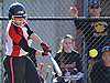 Sabrina Burrus #40, Mount Sinai catcher, drills a run-scoring double in the bottom of the first inning of a non-league varsity softball game against Sayville at Mount Sinai High School on Wednesday, Apr. 13, 2016. Mount Sinai won by a score of 10-9.