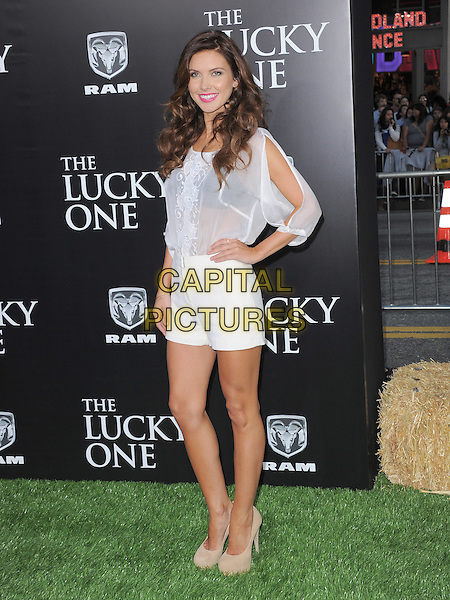 Audrina Patridge.The L.A. Premiere of 'The Lucky One' held at The Grauman's Chinese Theatre in Hollywood, California, USA..April 16th, 2012.full length white shorts sheer top slit sleeves  beige shoes hand on hip see through thru black bra.CAP/RKE/DVS.©DVS/RockinExposures/Capital Pictures.