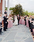 Bride and Groom leaving the church with friends.