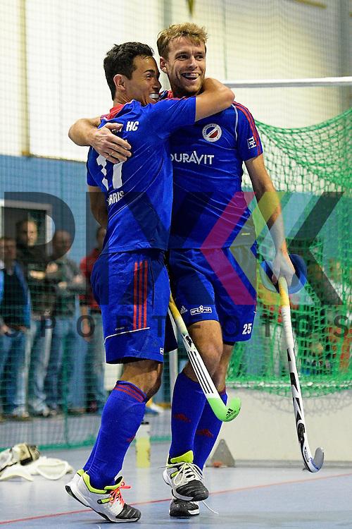 GER - Mannheim, Germany, January 10: During the 1. Bundesliga Sued Herren indoor hockey match between TSV Mannheim (red) and Mannheimer HC (blue) on January 10, 2016 at TSV Mannheim in Mannheim, Germany.  (L-R) Patrick Harris #17 of Mannheimer HC, Florian Woesch #25 of Mannheimer HC<br /> <br /> Foto &copy; PIX-Sportfotos *** Foto ist honorarpflichtig! *** Auf Anfrage in hoeherer Qualitaet/Aufloesung. Belegexemplar erbeten. Veroeffentlichung ausschliesslich fuer journalistisch-publizistische Zwecke. For editorial use only.