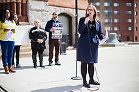 State Representative Michelle DuBois (D-10th Plymouth District) speaks at a rally in support of immigrants' rights outside Brockton City Hall after rumors of an Immigration and Customs Enforcement (ICE) raid traveled around the community in Brockton, Massachusetts, USA. The rally was organized in part by the Coalition for Social Justice. Rumors of the ICE raid went viral within the community after DuBois posted a warning about the supposed raid on Facebook and that undocumented immigrants should not go outside.