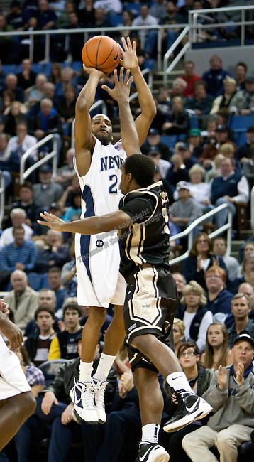 Nevada Wolf Pack guard Deonte Burton is fouled as he shoots a three point shot by Idaho Vandals guard Mansa Habeeb during their WAC basketball game held at the Lawlor Events Center on Saturday night February 4, 2012 in Reno, Nevada.
