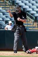 Umpire Seth Buckminster makes a call during an Arizona Fall League game between the Phoenix Desert Dogs and Surprise Saguaros at Phoenix Municipal Stadium on October 18, 2012 in Phoenix, Arizona.  The game was called after eleven innings with a 2-2 tie.  (Mike Janes/Four Seam Images via AP Images)