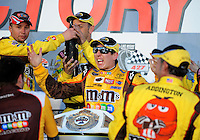 Mar. 1, 2009; Las Vegas, NV, USA; NASCAR Sprint Cup Series driver Kyle Busch celebrates with champagne after winning the Shelby 427 at Las Vegas Motor Speedway. Mandatory Credit: Mark J. Rebilas-