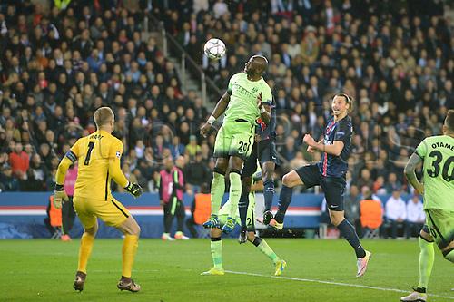 06.04.2016. Paris, France. UEFA CHampions League, quarter-final. Paris St Germain versus Manchester City.  ELIAQUIM MANGALA (mc) wins the header from ZLATAN IBRAHIMOVIC (psg)