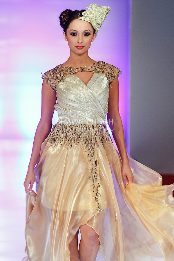 Model walks runway in an outfit from the Sushma Patel Fall 2014 collection during Couture Fashion Week Fall 2014, on February 14, 2014.