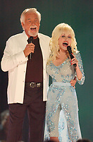 """20 March 2020 - Kenny Rogers, whose legendary music career spanned nearly six decades, has died at the age of 81. Rogers was inducted to the Country Music Hall of Fame in 2013."""" He had 24 No. 1 hits and through his career more than 50 million albums sold in the US alone. He was a six-time Country Music Awards winner and three-time Grammy Award winner. Some of his hits included """"Lady,"""" """"Lucille,"""" """"We've Got Tonight,"""" """"Islands In The Stream,"""" and """"Through the Years."""" His 1978 song """"The Gambler"""" inspired multiple TV movies, with Rogers as the main character. File Photo: 08 June 2005 - Nashville, Tennessee - Dolly Parton and Kenny Rogers perform together for the first time in fifteen years. CMT 100 Greatest DuetsTaping to air on CMT September 17, 2005 held at Gaylord Entertainment Center. Photo Credit: Laura Farr/AdMedia"""
