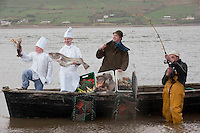Patrick Moroney (12) on left holds a freshly caught lobster while  Brian Keary, Jonathon Keary and Donie McCarthy haul in their catch at Cromane Strand in County Kerry on Tuesday at the launch of the first Ring of Kerry Tourism and Local Produce Showcase, which will take place in Jacks' Coastguard Restaurant in Cromane, on next Monday April 11th at 7pm.  At the showcase will be local providers and producers of tourism products like M&oacute;r Active, which featured on RTE's Families in the Wild, Cappanalea Outdoor Centre, Wilmas Cheese, Kenmare Chocolate, Sunhill Honey and will be opened by  Minister for Arts, Heritage &amp; Gaeltacht Affairs Jimmy Deenihan.<br /> Picture by Don MacMonagle<br /> <br /> FREE PHOTO FROM KERRY TOURISM SHOWCASE