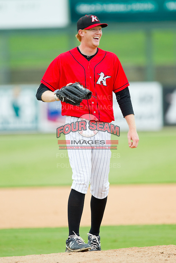 Kannapolis Intimidators relief pitcher Ryan Bollinger (31) is all smiles after having made a fantastic fielding play during the South Atlantic League game against the Lexington Legends at CMC-Northeast Stadium on July 31, 2013 in Kannapolis, North Carolina.  The Intimidators defeated the Legends 3-2.  (Brian Westerholt/Four Seam Images)