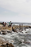 USA, California, San Diego, a family gathers along the rocks at Children's Pool Beach in La Jolla