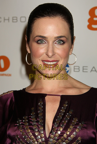 """DANIELLE BISUTTI .At Go Campaign's 2nd Annual """"Go Go Gala"""" held at Social, Hollywood, California, USA, .20th November 2009..portrait headshot hoop earrings hair up silver gold purple studs studded .CAP/ADM/MJ.©Michael Jade/AdMedia/Capital Pictures."""