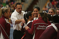 17 February 2006: Alex Pintchouk, Chris Swircek, Jessica Louie cheer after Liz Tricase gets a 10 on her high bar performance during Stanford's win over the University of Arizona at Burnham Pavilion in Stanford, CA.