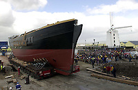 JEANIE JOHNSTON LAUNCHED 19-4-00.Inch by inch the replica famine Jeanie Johnston rolls onto a barge at Blennerville yesterday. The ship will now be taken to Fenit port for final fitting and sea trials..Picture by Don MacMonagle