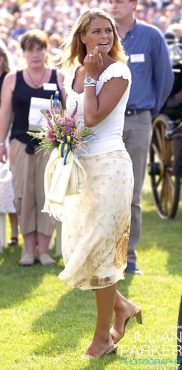 CONCERT IN BERGHOLM TO CELEBRATE CROWN PRINCESS VICTORIA.OF SWEDEN'S 25TH BIRTHDAY.  14/7/02 . PICTURE: UK PRESS  (ref 5105-21).PRINCESS MADELEINE OF SWEDEN.