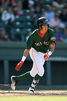 Shortstop Ricardo Cubillan (40) of the Greenville Drive runs out a batted ball in a game against the Charleston RiverDogs on Sunday, April 29, 2018, at Fluor Field at the West End in Greenville, South Carolina. Greenville won, 2-0. (Tom Priddy/Four Seam Images)