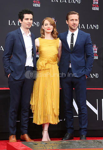 Hollywood, CA - DECEMBER 07: Damien Chazelle, Emma Stone, Ryan Gosling, At Ryan Gosling And Emma Stone Hand And Footprint Ceremony At TCL Chinese Theatre IMAX, California on December 07, 2016. Credit: Faye Sadou/MediaPunch