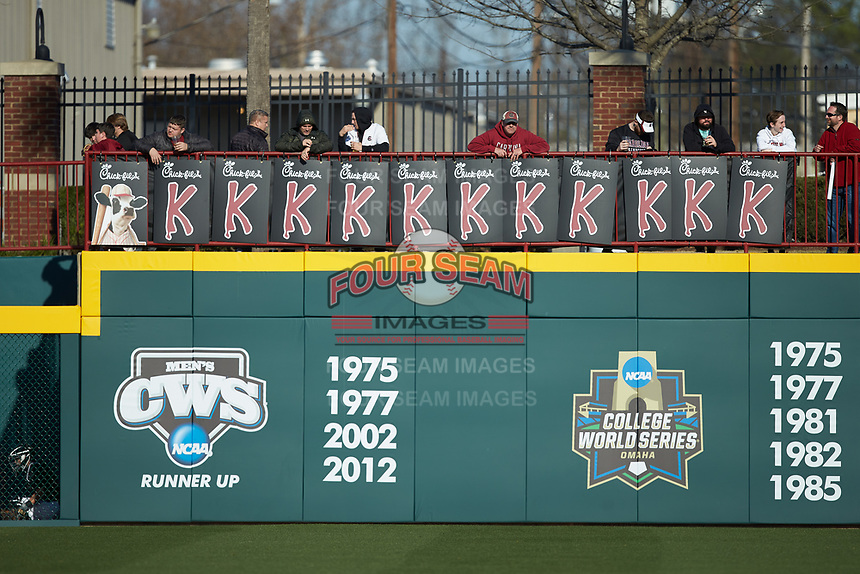 "A fan hangs ""K"" signs sponsored by Chick-Fil-A on the outfield wall during the NCAA baseball game between the Holy Cross Crusaders and the South Carolina Gamecocks at Founders Park on February 15, 2020 in Columbia, South Carolina. The Gamecocks defeated the Crusaders 9-4.  (Brian Westerholt/Four Seam Images)"