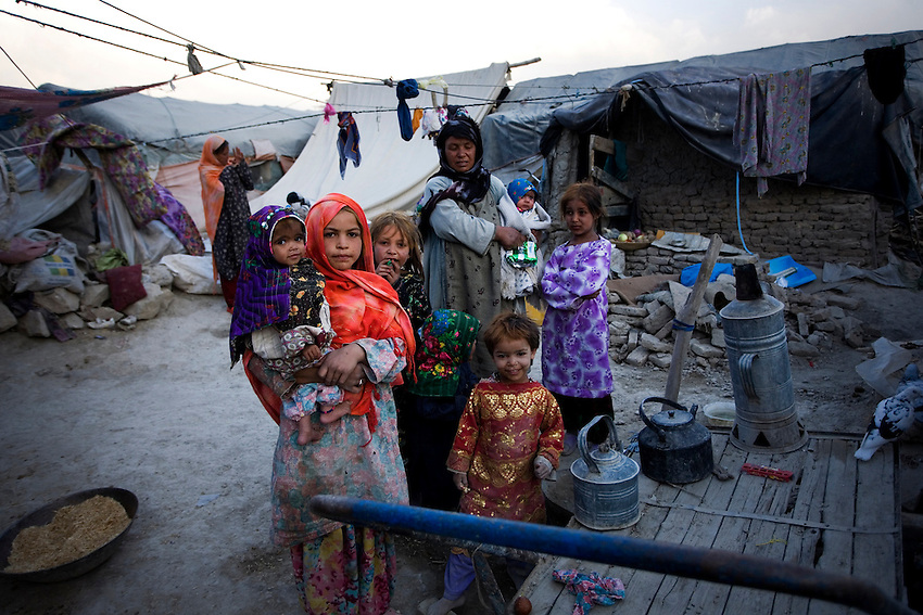 Displaced Afghan children in Chamane Babrak, a tented slum community for displaced Afghans just west of Kabul, Afghanistan, Monday, Oct 5, 2009. The majority of the familes in Chamane Babrak are returnees from Iran.