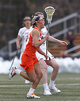 Syracuse University defender Linley Block (16) brings the ball forward.   Syracuse University (orange) defeated Boston College (white), 17-12, on the Newton Campus Lacrosse Field at Boston College, on March 27, 2013.