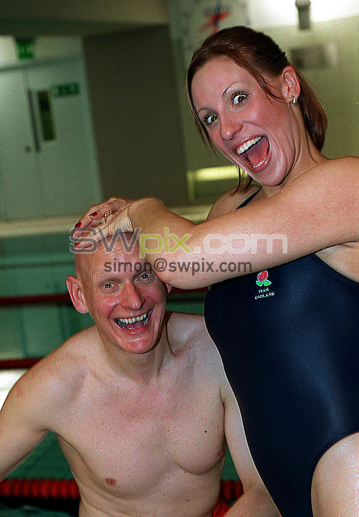 Pix: Ben Duffy/SWpix.com....Swimming... Butlins Swimathon 2002......03/12/2002...COPYRIGHT PICTURE>>SIMON WILKINSON>>01943 436649>>..President of Swimathon, Duncan Goodhew and top Backstroke swimmer, Sarah Price meet up at the Chelsea Viallage sports centre to promote the 2002 Butlins Swimathon