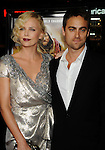 "HOLLYWOOD, CA. - November 04: Charlize Theron and Stuart Townsend.. arrive at the AFI Fest 2009 gala screening of ""The Road"" at Grauman's Chinese Theatre on November 4, 2009 in Hollywood, California."