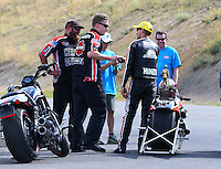 Jul. 20, 2014; Morrison, CO, USA; NHRA pro stock motorcycle rider Andrew Hines (right) celebrates with his crew after winning the Mile High Nationals at Bandimere Speedway. Mandatory Credit: Mark J. Rebilas-
