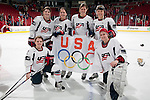 January 5, 2010: Former and current Wisconsin Badger players on the USA Hockey roster pose for a photos after an exhibition women's hockey game against the Wisconsin Badgers at the Kohl Center in Madison, Wisconsin on January 5, 2010.   Team USA won 9-0. (Photo by David Stluka)