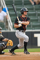 Brian Conley #9 of the Delmarva Shorebirds follows through on his swing against the Kannapolis Intimidators at Fieldcrest Cannon Stadium May 14, 2010, in Kannapolis, North Carolina.  Photo by Brian Westerholt / Four Seam Images