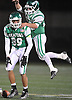 Luke Farrant #89 of Seaford, left, gets congratulated by Danny Roell #23 after catching a pass for a first down on a faked punt play in Nassau County varsity football Conference IV semifinals against Locust Valley at Hofstra University on Saturday, Nov. 12, 2016. Seaford won by a score of 28-14.