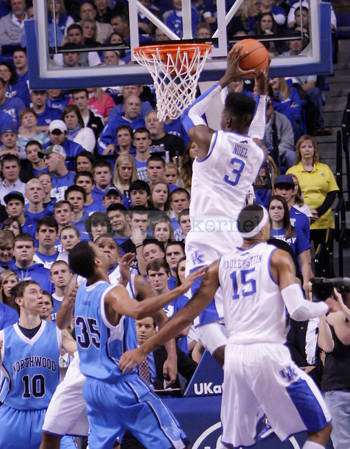Freshman Forward Nerlens Noel pulls down a rebound during the first half of the University of Kentucky vs. Northwood Basketball exhibition game at Rupp Arean in Lexington, Ky., on, {November} {1}, {2012}. Photo by Jared Glover | Staff