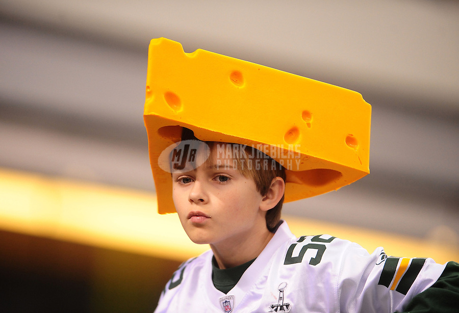 Feb 6, 2011; Arlington, TX, USA; A young Green Bay Packers fan wears a cheesehead hat during Super Bowl XLV against the Pittsburgh Steelers at Cowboys Stadium. The Packers defeated the Steelers 31-25. Mandatory Credit: Mark J. Rebilas-