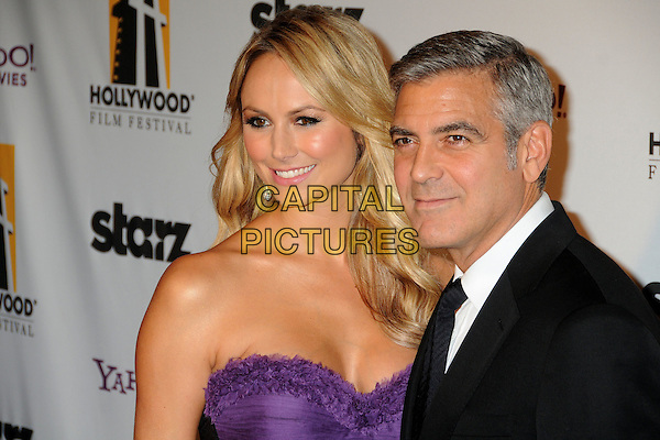 Stacy Keibler and George Clooney.15th Annual Hollywood Film Awards Gala held at the Beverly Hilton Hotel, Los Angeles, California, USA..24 October 2011.headshot portrait purple strapless black suit white shirt couple .CAP/ADM/BP.©Byron Purvis/AdMedia/Capital Pictures.