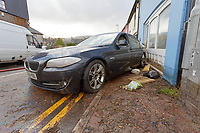 Pictured: A BMW car is rests against a wall in New Road.<br /> Re: Cleanup after storm Dennis in Crickhowell, Wales, UK.