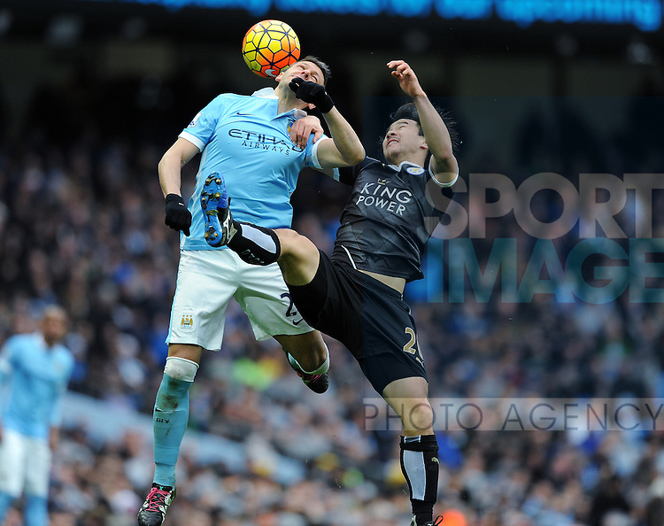 Shinji Okazaki of Leicester City  is challenged by Martin Demichelis of Manchester City<br /> - Barclays Premier League - Manchester City vs Leicester City - Etihad Stadium - Manchester - England - 6th February 2016 - Pic Robin Parker/Sportimage