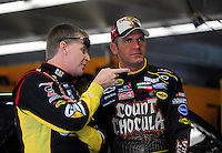 Oct. 15, 2009; Concord, NC, USA; NASCAR Sprint Cup Series driver Jeff Burton (left) talks with teammate Clint Bowyer during practice for the Banking 500 at Lowes Motor Speedway. Mandatory Credit: Mark J. Rebilas-