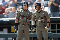 Vanderbilt Commodores outfielder JJ Bleday (51) and Julian Infante (22) greet teammate Austin Martin (16) at the plate after his second home run during Game 3 of the NCAA College World Series against the Louisville Cardinals on June 16, 2019 at TD Ameritrade Park in Omaha, Nebraska. Vanderbilt defeated Louisville 3-1. (Andrew Woolley/Four Seam Images)