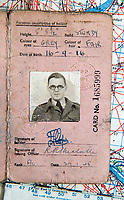 BNPS.co.uk (01202 558833)<br /> Pic: PhilYeomans/BNPS<br /> <br /> Flt lt Cooper's wartime ID card.<br /> <br /> Unearthed - fascinating unseen archive of cameras, photographs, documents and medals from a British aerial reconnaisance expert who fought all the way through Africa and southern Europe in WW2.<br /> <br /> Flt Lt Eric Cooper from London kept all his wartime paraphernalia, including his K20 handheld camera and stereoscopic plotting instruments until his death in Devon aged 96 in 2012.<br /> <br /> The incredible photographs show bombing raids, amphibious landings and badly damaged aircraft alongside off duty snaps of the campaign throughout the mediterraenean.<br /> <br /> His nephew is now selling the compelling collection at Plymouth Auction Rooms in Devon next week.