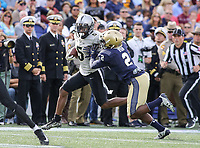 Annapolis, MD - October 21, 2017: UCF Knights wide receiver Dredrick Snelson (5) gets pushed out of bounds by Navy Midshipmen safety Jarid Ryan (2) during the game between UCF and Navy at  Navy-Marine Corps Memorial Stadium in Annapolis, MD.   (Photo by Elliott Brown/Media Images International)