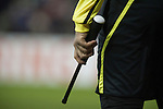 One of the goal line referee's assistant holding a piece of signalling equipment at the Britannia Stadium, Stoke-on-Trent, during the UEFA Europa League last 32 first leg between Stoke City and visitors Valencia. The match ended in a 1-0 victory from the visitors from Spain. Mehmet Topal scored the only goal in the first half in a match watched by a crowd of 24,185.