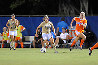 21 August 2011:  FIU's Marie Egan (13) moves the ball to the goal as Florida's Maggie Rodgers (5) attempts to defend in the second half as the University of Florida Gators defeated the FIU Golden Panthers, 2-0, at University Park Stadium in Miami, Florida.