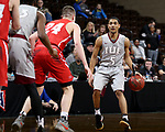 SIOUX FALLS, SD - MARCH 12:  Jacoby Claypool #5 from IU East brings the ball up court against Kyle Mangas #24 from Indiana Wesleyan during their semifinal game at the 2018 NAIA DII Men's Basketball Championship at the Sanford Pentagon in Sioux Falls. (Photo by Dave Eggen/Inertia)