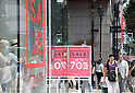 "July 1, 2016, Tokyo, Japan - Shoppers walk on the road in Tokyo's Ginza district on Friday, July 1, 2016, while an apparel shop displays a large ""Sale"" sign. Japan's consumer price index (CPI) fell 0.4 percent in May from previous year for the third straight month and the biggest drop in three years.  (Photo by Yoshio Tsunoda/AFLO) LWX -ytd-"